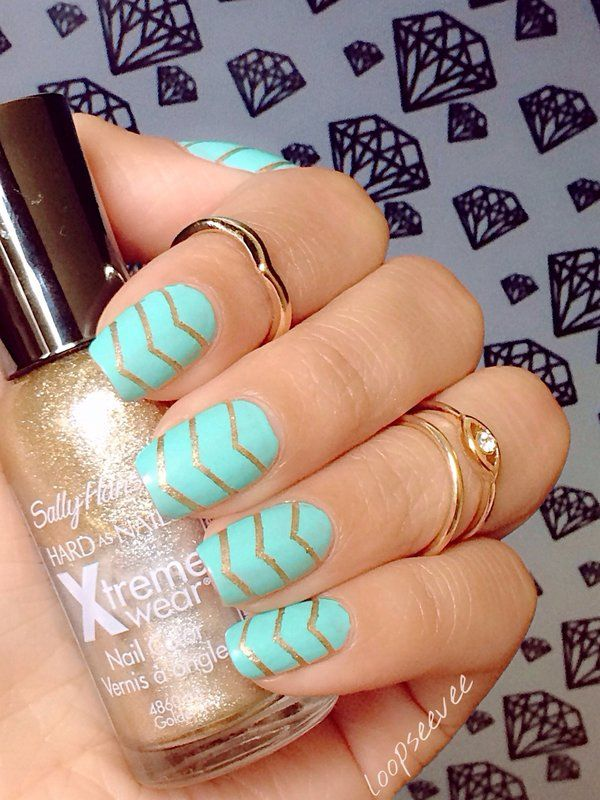 """Pinterest: @loopseevee   Mint and gold nails. Used sally Hansen nail polish in """"485 Golden-I"""" for the V lines and for the mint I used Summer Brights nail polish."""