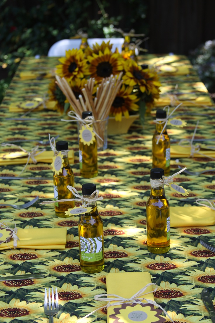 Rustic Italian, Tuscan themed tablescape with sunflowers, grissini, and olive oil favors