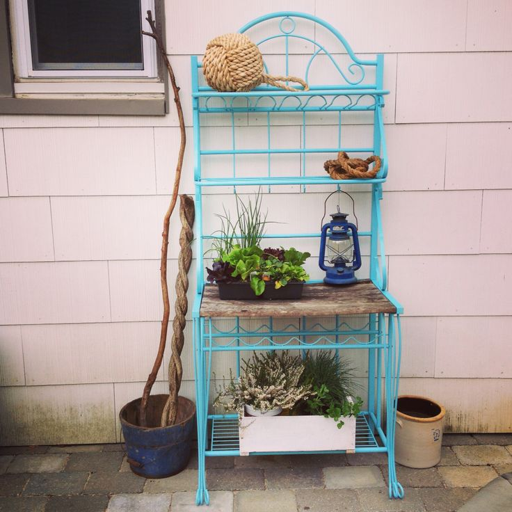 Blue bakers rack. Repurposed for outdoor storage. Bakers rack for patio. Rust oleum Aqua blue. Coastal feel patio.