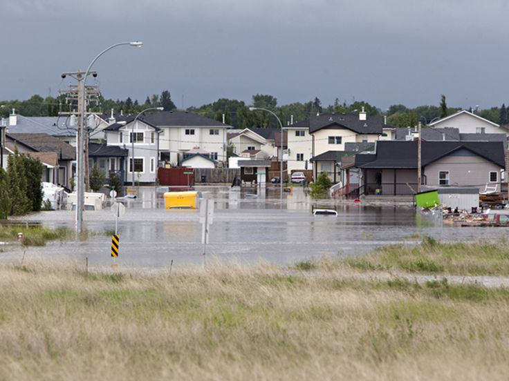 The east end of High River, Alberta sits flooded on Friday June 21, 2013 after the Highwood River, overflowed its banks Thursday. The town was locked down by emergency crews as relief efforts continued.
