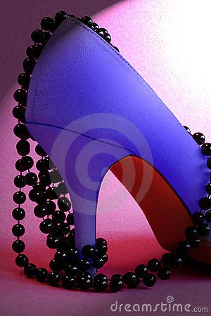 a suede stiletto heel shoe and beads