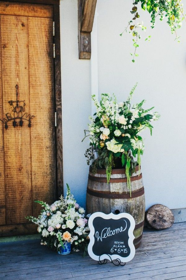 Rustic barrel, romantic flowers, and chalkboard sign | Jesse Holland Photography