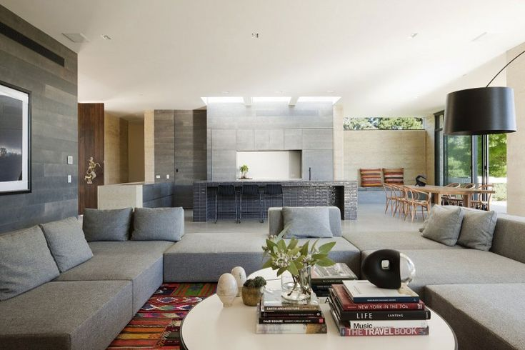 Love the color palette and windows above minimal fireplace. Merricks House by Robson Rak Architects