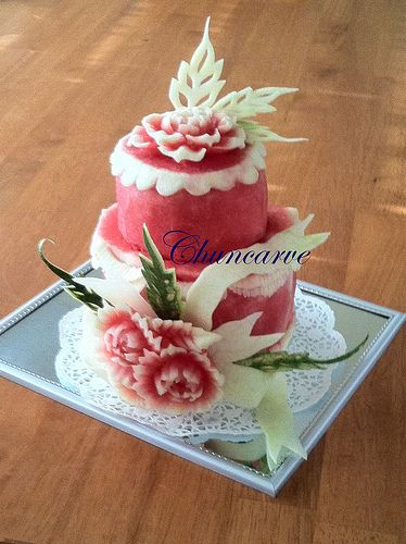 """Watermelon cake B by Chuncarve - phrase used when referring to the Thai Culinary Art of Fruit and Vegetable Carving. Chuncarve slogan is """"Fruit Stylist"""". Which I specialize in fruits and vegetables carving following the traditional Thai method of skill that has been originated practiced in Thailand for centuries. Thai fruit and vegetable carving adds beauty and immense value to every dish, benefits are truly rewarding experience for personal, professional and managerial aspect."""