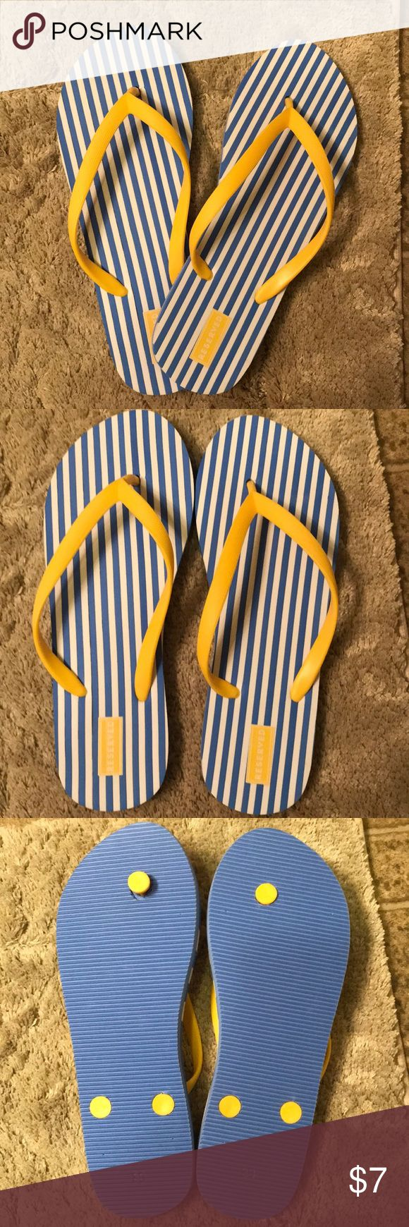Reserved striped flip flops Blue and white striped flip flops with yellow straps. Size 8 US. Never worn and in perfect condition. Perfect for summer! Reserved Shoes Sandals