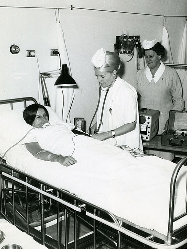 A9012(lxvi)b- A nurse tends to a patient in the intensive care ward, Royal Newcastle Hospital c. late 1960's