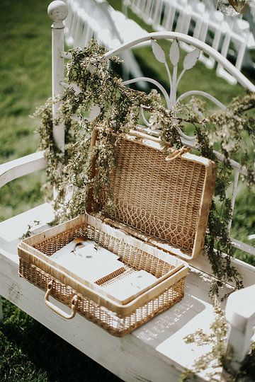 Vintage look captured with the wicker basket and floral ivy garland on the white washed bench. Photo from Ashley & Jacob collection by Jenna Borst Photography.