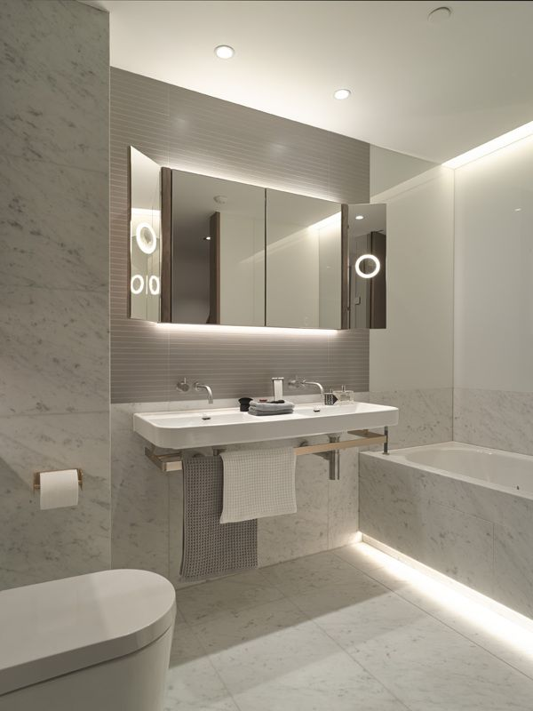 Cabinet with lights + white & grey tiles that exude clean, classy, hotel look