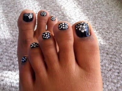 Polka dot and flower toe nails.