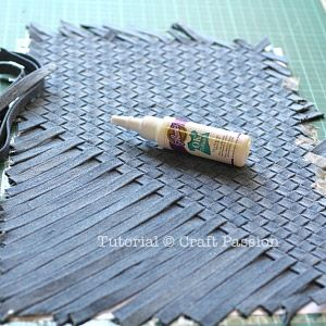 Weave strips of denim to make fabric for a purse, bag or  ??? Looks a bit fiddly, but the end result is eye catching