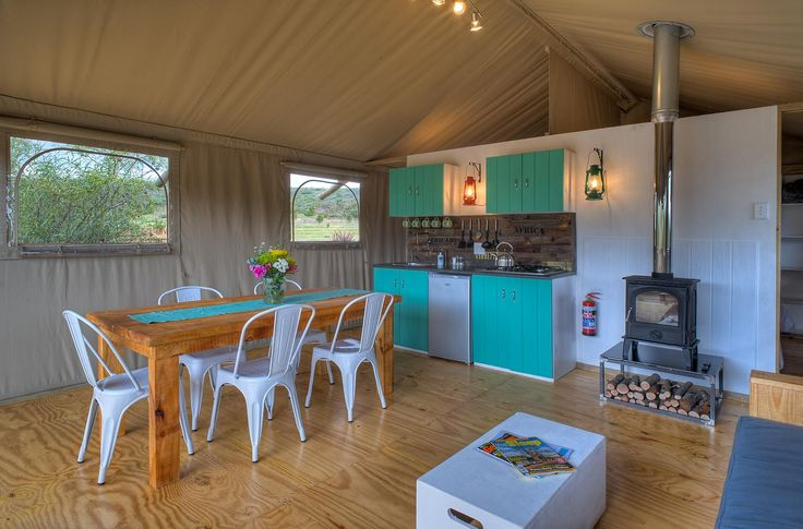 AfriCamps Glamping at Robertson, South Africa. This AfriCamps Glamping location is situated in Pat Busch Mountain Reserve. 2000 Hectares of spectacular mountain fynbos with streams, mountain dams, birdlife and various animals such as bucks, fallow deer, Nguni cows and even a very shy leopard.  Our glamping tents are tucked away in the Cape fynbos and look out over a folded green valley with the Langeberg as a gorgeous backdrop.