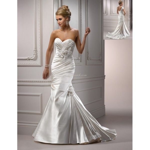 Check this dress out at Joanna's Bridal! We have this beautiful dress in stock!