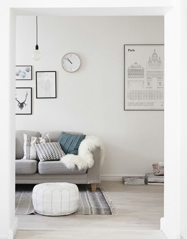 A nordic interior living room picture wall  posters white and grey ocean green cushion