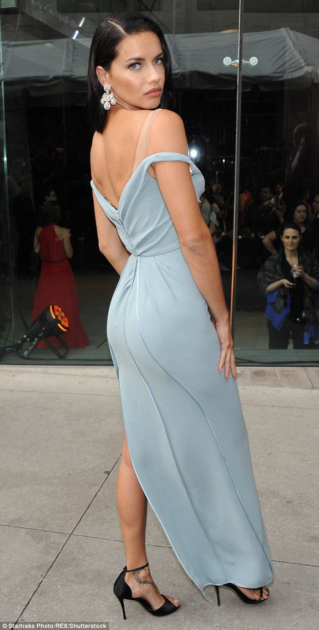 Curvaceous: The Victoria's Secret Angel paired the almost backless frock with black heels ...