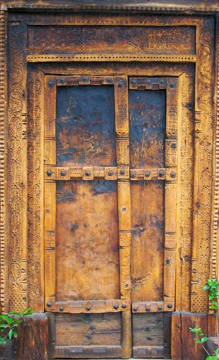 you can faintly see the carving on the frame of the door.
