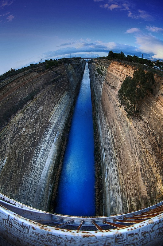 Corinth Canal, Greece. amazing feat of a short cut connecting the Gulf of Corinth with the Aegean Sea, saves 430 miles! Built between 1882-1893 and 4 miles long, 26 feet deep,70 ft wide. It took 11 years and 4,000 workers to excavate 12 million cubic mt of hard rock. Im-passable for modern freight ships now and used mostly by tourist liners. Around 11,000 ships travel through every year! .