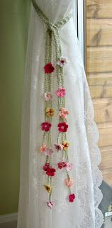 Here's a great project for getting rid of those scraps of yarn; curtain tiebacks! The Cascading flowers look lovely! Could do other shapes such as hearts or stars to coordinate with changing holidays/seasons