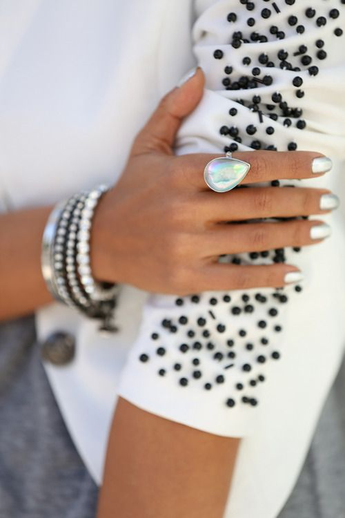 Uniquely styled beautiful white opal ring.  (**I also love the beaded sweater this model is wearing.**)