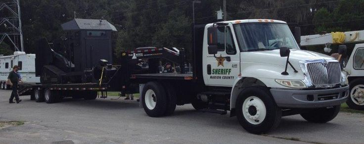 The Marion County Sheriff's office LOVES their custom goose neck flatbed! Want one? Check out all our options. Give us a call at 800-330-1229 or go to our website today. http://actionfabrication.com/trucks-on-the-jobsite/