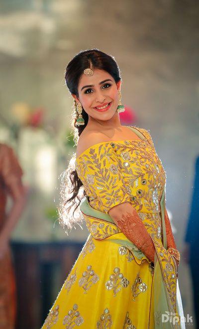 Sangeet Lehengas - Yellow Off-Shoulder Lehenga with Silver Gota Embroidery | WedMeGood  #wedmegood #indianbride #indianwedding #lehenga #yellow #silver #bridal #gotta #mintgreen