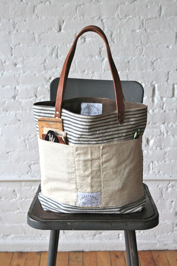 Sturdy, worn-in ticking fabric salvaged from a 1950's era mattress cover has been paired with a 1950's era work apron and turned into a perf...Bag measures approximately 15 in wide, 13 in tall, 4.5 in deep.