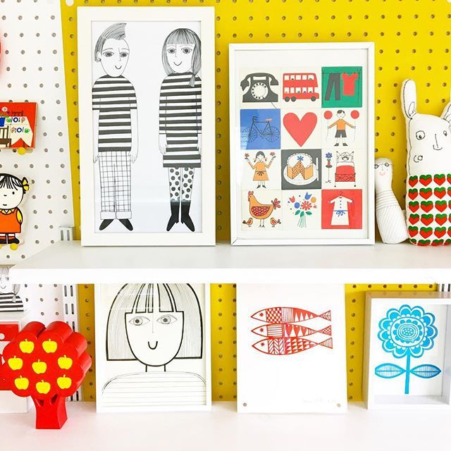 Studio shelfie - various framed illustrations and screen prints, handmade toys, some framed vintage picture dominoes form the 60s or 70s and my favourite red apple tree money box. (That's still empty!)