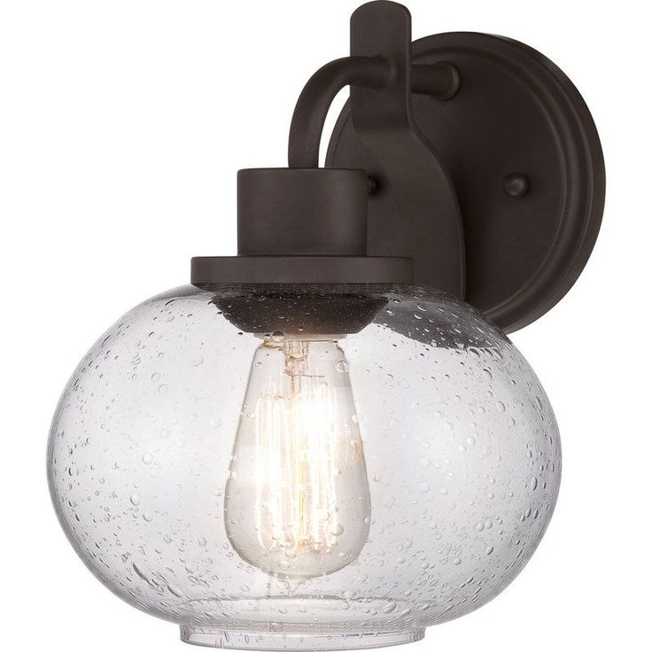 quoizel trilogy wall sconce a premium seeded glass globe shade and simple base in old bronze gives the quoizel trilogy wall sconce its reclaimed vibe