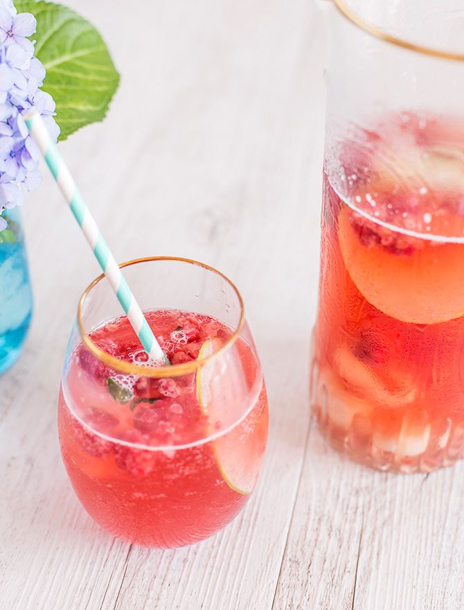 Pretty Party Iced Tea Punch, perfect for girly gatherings, with lychee and berries. Can be made with booze or without - both are delicious!
