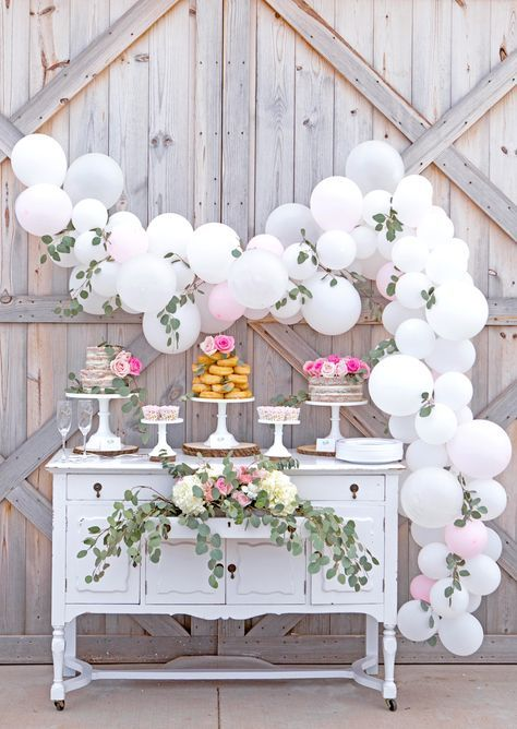 Elegant bridal shower dessert display idea - balloon arch with vintage dresser and assorted desserts {Courtesy of Lillian Hope Designs}