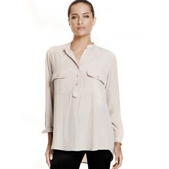 Mela Purdie Tab Front Shirt - Mousseline A fashionable classic, the tab front shirt is an essential for your capsule wardrobe. Cut for a slightly loose fit that is comfortable but still flattering, this style features relaxed soft patch pockets, tab front detail and full length sleeve. Wear yours with skinny jeans or soft woven pants for a smart yet relaxed look.