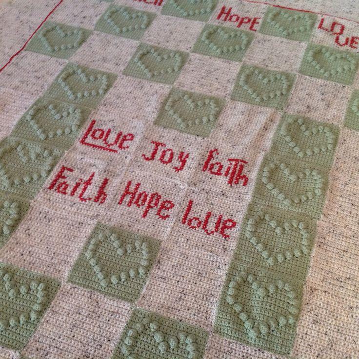 Hearts, cross stitch and crochet blankie.