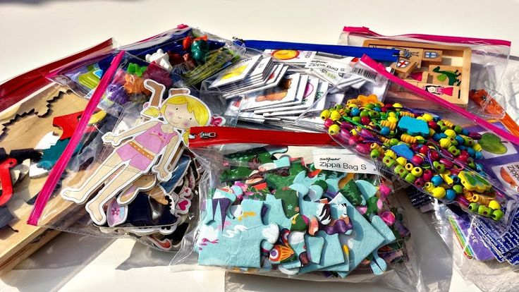 Simply take toys out of boxes and put each in a zipper bag … if there is a jigsaw picture on the box or game instructions just cut them out and add to the bag.