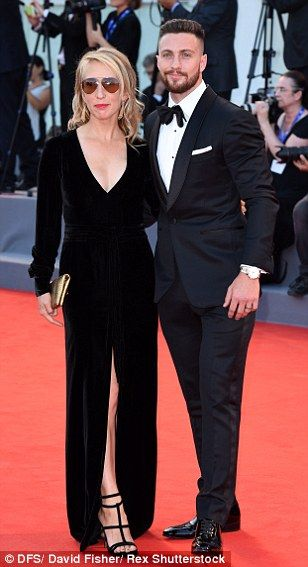 Sartorially in sync! Sam Taylor-Johnson and Aaron Taylor-Wood complemented each other in their all-black ensemble
