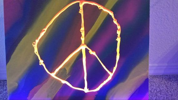 Spray painted 11 X 17 canvas background, peace sign made with orange UV reactive paint, glows under black light! Buying this helps the careers of