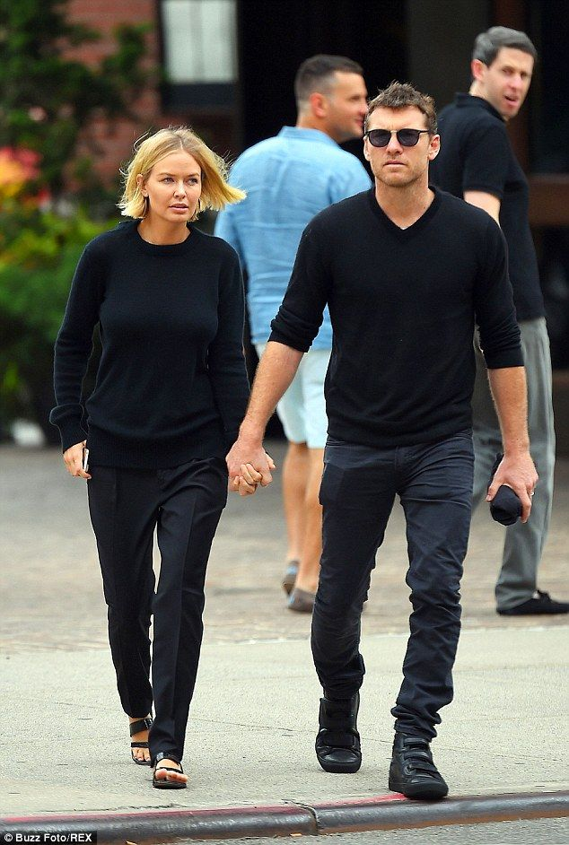Lara Bingle and Sam Worthington both wore matching black ensembles as they went for a stroll in New York