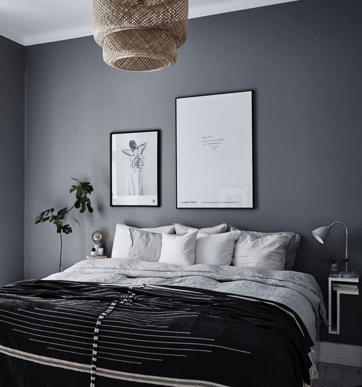 The bedroom wall is painted in a warm dark grey, which makes the room look  very peaceful and relaxing.