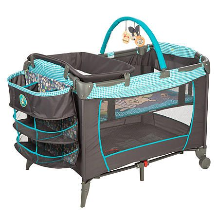 The Hundred Acre Wood is just the right place for naptime and playtime in this adorable blue and grey toss print play yard with checkered patterns and retro designs featuring Winnie the Pooh that's spacious and easy to store and transport when you and Baby are on the go. Featuring a toy arch with Winnie the Pooh and Tigger to keep your baby company, an easy-clean changer and a deluxe organizer, this play yard is great at home or on-the-go.