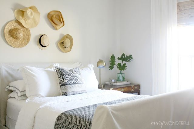 Crazy Wonderful: eclectic neutral guest bedroom before and after, straw hat wall, DIY slipcovered sleigh bed