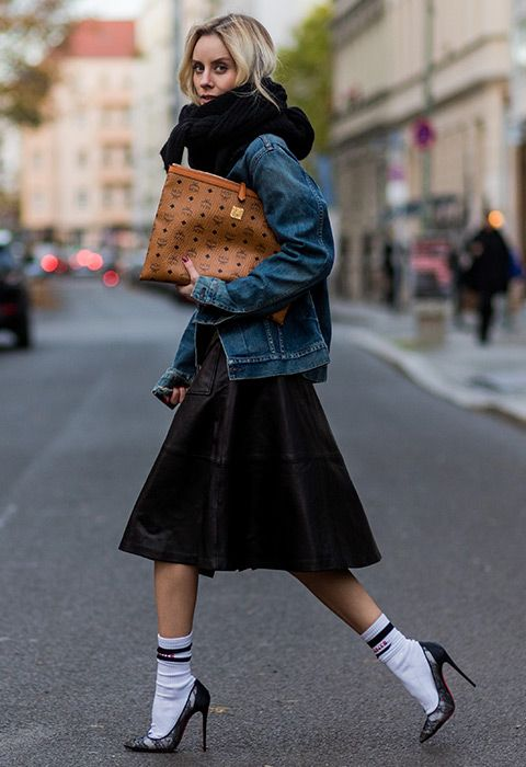 Lisa Hahnbueck (@lisarvd) wearing a navy dark blue oversized Boyfriend Denim Jacket Citizens of Humanity Wilkes, black H&M Knit, black leather skirt, white Vetements sexual fantasies cotton blend Socks, black Christian Louboutin Lace heels 120,  MCM clutch pouch in Berlin