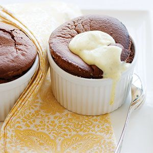 Flourless Chocolate Soufflés  Notes: You can fill the soufflé dishes up to 1 day before baking and chill them (allow up to 5 extra minutes to bake). Increase or decrease the number of soufflés with this simple formula: For each soufflé, use 1/2 tsp. butter, 1 tbsp. sugar, 1 oz. chocolate, 1 tbsp. milk, 1/2 egg yolk, 1 egg white, and a small pinch of both salt and cream of tartar.