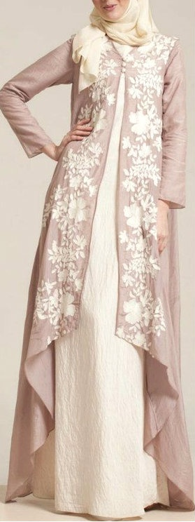 Creme abaya with cascading side panels create an elegant appeal