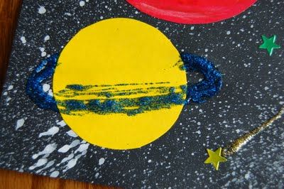 Spray paint, glitter and glue. Space/ planets.