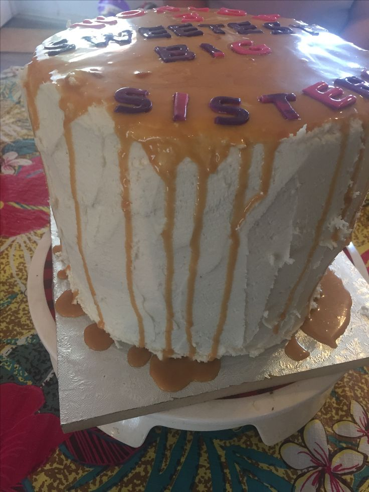 Chocolate cake with cheesecake middle with Carmel buttercream and caramel ganache