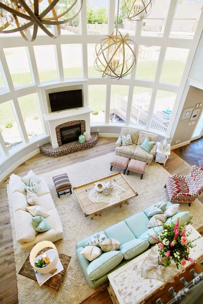 Pastel colors and big glass wall in this gorgeous living room inspired by beach house decor