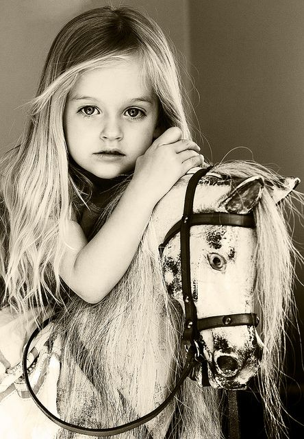 Really beautiful picture using a rocking horse prop.