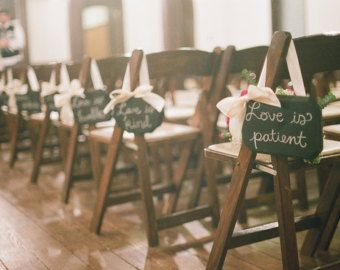 Love these chalkboard signs down the aisle