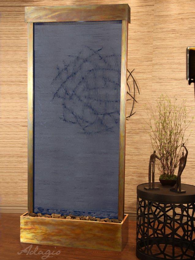 Floor standing blue glass waterfall https://waterfalldecor.com http://waterfallnow.com