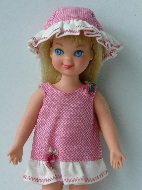 Tutti - exactly mine! Buying her was one of the most exciting days of my life? I got her with a big fuzzy grey poodle at the Rose's dime store