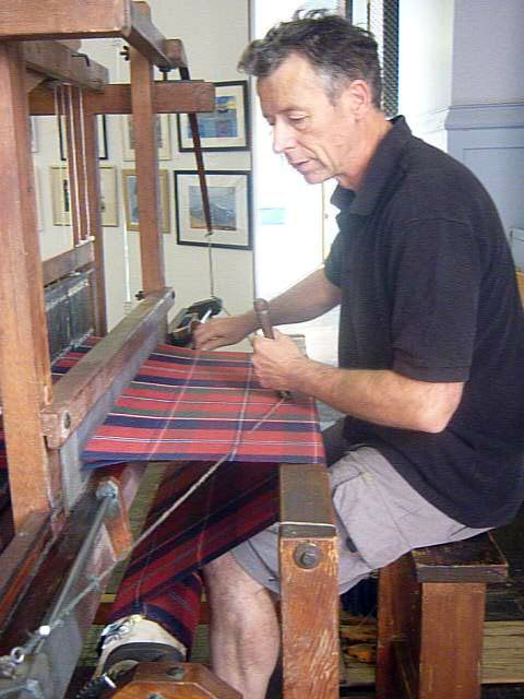 Tartan historian Peter MacDonald handweaving the MacDonald of Glenaladale tartan on a traditional single box flying shuttle loom.