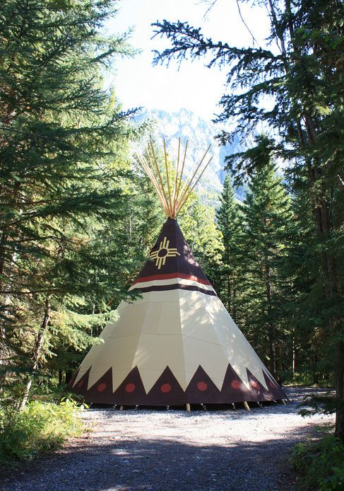 Coolest places to go glamping in Canada: In stunning Kananaskis, Alberta, you can rent a traditional Sioux canvas teepee at Sundance Lodges. #alberta #teepee